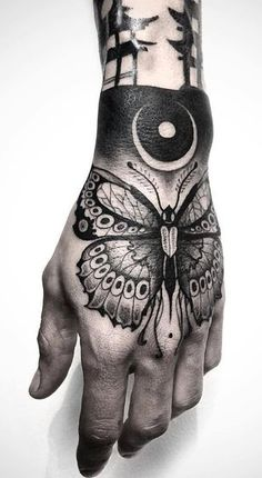 Black butterfly tattoo accompanied by other desings Francesc Llorens - Barcelona Spain