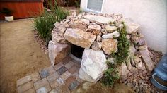 Dog house!  Use your durable plastic dog house, add rock.  Interesting.... but I bet I could make it look better.