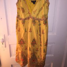 1X yellow sun dress Yellow sundress. Some sequins are loose (per photo) and some have fallen off but doesn't affect the overall quality. It's a beautiful dress and it hits right above knee. Back is stretchy. Forever 21 Dresses