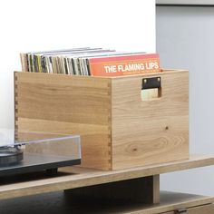 LAB POINTS - handcrafted wood record crate - constructed of locally sourced White Oak - exposed English dovetail joinery for both beauty and strength - vegetable tanned leather handles - holds up to 1                                                                                                                                                                                 More
