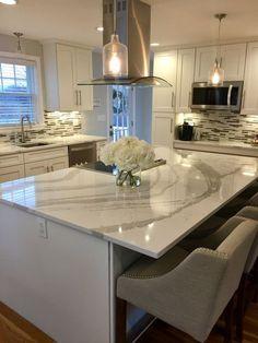White shaker kitchen cabinets with white and gray Quartz from Cambria Brittanicca.
