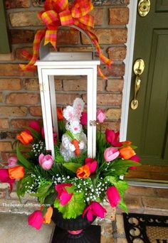 I adore this bunny and the tulip decorations on this porch! Spring Decorating for the Front Porch