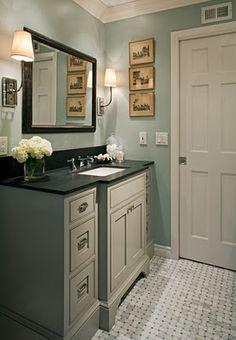 rustic rooster interiors: bathroom. blue walls, painted vanity, dark top, marble basketweave floor