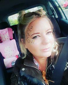 Leopard facepaint gold glitter face buns hair updo nude lips makeup cat eyes