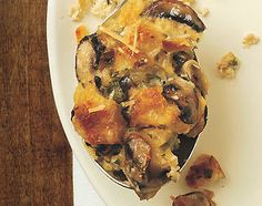 Savory bread pudding: this rich, custard-like stuffing is also a great main-course option for vegetarians at the Thanksgiving table; it would be nice with a salad for brunch or lunch, too. Recipes With Parmesan Cheese, Cheese Recipes, Cooking Recipes, Bread Recipes, Pudding Recipes, Meatless Recipes, Vegetarian Dinners, Side Recipes, Vegetarian Food