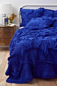 I searched for this bright blue bedspread for hours-- THIS is what I want for our new bedroom! Reminds me of the waves in the Caribbean!