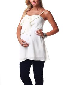 Flirty and utterly feminine details—like a chiffon bow, flattering gathered empire waist and tank silhouette—give this maternity tunic its pretty presentation. Pair it with skinny jeans or leggings for a posh look in any trimester.100% polyesterHand wash; hang dryMade in the USA<...