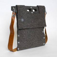 Carga 01 Notebook Tote    Made of industrial wool felt, the Carga 01 Notebook Tote is a small laptop/portfolio bag perfect for the urban professional.