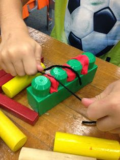 What a great way to teach flossing ~ blocks, clay, and yarn! Could use smaller Lego blocks with older kids! From Too Many Crafts, Too Little Time: Pre-K Week 6: Health Week