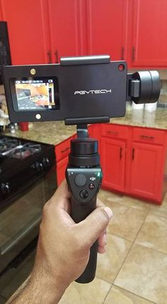 """Testing out the DJI Osmo mobile gimbal.  It's designed to work with your s7e mobile phone, and with this adapter, will also work with gopro hero 3,3+,4. Great addition to the quiver. <a class=""""pintag searchlink"""" data-query=""""%23DigitalGuruShop"""" data-type=""""hashtag"""" href=""""/search/?q=%23DigitalGuruShop&rs=hashtag"""" rel=""""nofollow"""" title=""""#DigitalGuruShop search Pinterest"""">#DigitalGuruShop</a>"""