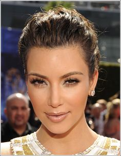 Kim Kardashian natural makeup..  Well, kind of natural anyway. She looks so much lovelier without the dramatic make up.