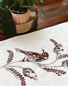 Off white table runner approx., linen, with my own design of a New holland Honey Eater bird and banksia, printed in warm brown with eco-friendly screen printing ink (Permaset). Created and printed in Fremantle Western Australia Printing Ink, Screen Printing, Cute Australian Animals, Kangaroo Paw, Perfect Match, Linen Fabric, Table Runners, Bird, Dinner Table