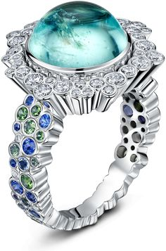 An abundance of lively colour dances through this ring, from an astounding, electric blue cabochon paraiba tourmaline, through a halo of pristine diamonds and a poetic tumble of blue sapphires, tsarvorites, chrome tourmaline, aquamarine and topaz, placed as if fallen, into the 18ct white gold band. The illusion of chaos masks the painstaking crafting that …