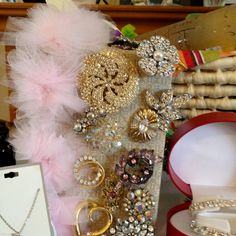 "For my sister's bridal shower each guest was asked to bring a brooch, this was how we displayed them. The insert in the invites ""Erin wants a sparkling bridal bouquet, let's help her shine on her wedding day. Bring vintage, plain, light pink or champagne crystals will do. Erin will be excited for this surprise from you."""