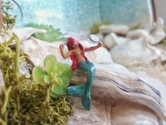 1 COLOR MAYBE VARY FROM YOUR COMPUTER SCREEN THIS LISTING IS FOR: look like ariel mermaid  1 miniature wonderful mermaid ,perfect for your miniatures crafts like terrarium , diorama ,project layout diorama ring ,ect...  You can choose her hair color at checkout menu.  SIZE :   approximately 7/8 tall x 1/2arm to arm x 1/4  N.B: terrarium , plants, or any decorative picture elements are not included!     !!!!!!!!!!!!!!!!!! WARNING!!!!!!!!!!!!!!   WARNING NOT SUITABLE FOR CHILDREN...