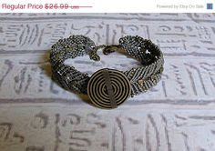 SALE Micro macrame friendship bracelet.  Karma bracelet in gray and matte metallic khaki,. $24.29, via Etsy.
