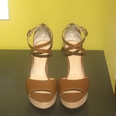 """Cognac Wedges Who's ready for Spring? You certainly can be with these beauties! They're a great neutral color so they can be worn with everything from shorts and dresses to rompers and jeans! Gold hardware, zipper and buckle closure, crisscross straps on top of foot. 5"""" wedge height and 1"""" platform. Banana Republic Shoes Wedges"""