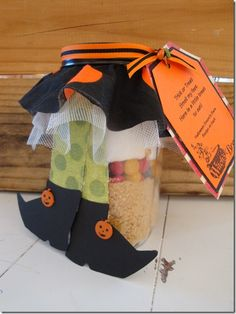 Halloween Smore's in a Jar ~ Trick or Treat smell my feet... here's a little treat to eat! What a fantastic idea to give to your coworkers, neighbors, teachers, etc - so cute! Mason jar is filled with ingredients for Halloween S'more bars. Also save this idea for  a Wizard of Oz or Harry Potter themed party