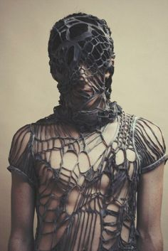 Is it to hide deformity, scars, stains? Or is it to mask his glorious beauty? A pet. Dark Fashion, Fashion Art, Fashion Design, Eiko Ishioka, Textiles, Future Fashion, Fabric Manipulation, Post Apocalyptic, Look Chic
