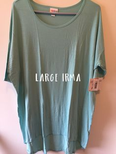 """Large Irma.   Shipping is $3.50 for one item or $7 flat rate for 2+ items. Please comment """"SOLD"""" and message me with your state of residence and email address for me to send you an invoice.   Visit me at https://www.facebook.com/BrookieBLuLaRoe/"""