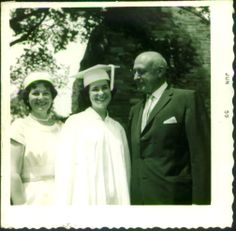 My mom with her parents, my grandparents. I love my nana's pillbox hat, pearls, and although you can't see them in this photo, gloves.