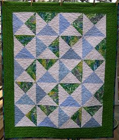 """Greener Pastures baby quilt - hourglass blocks made with 10"""" layer cake squares."""