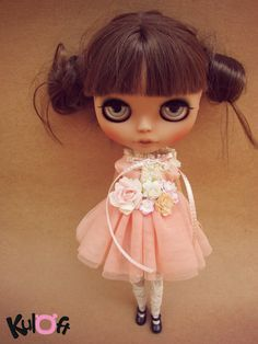 love her little outfit, eye makeup, and hair