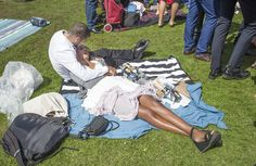 Dozens of racegoers at Emirates Stakes Day were seen sprawling on the grass while their friends continued to quaff champagne around them Melbourne Cup, Stakes Day, Finals, Grass, Champagne, Carnival, Friends, Amigos, Grasses