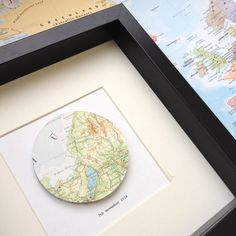 Map art circle - 1 special place - large hand cut map circle - travel gift - world map - uk map - framed artwork by MadeByMrsJones on Etsy https://www.etsy.com/listing/212150255/map-art-circle-1-special-place-large