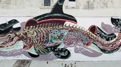 Born to a family of hunters, Austrian street artist Nychos has been fascinated with animal anatomy his whole life. Cartoonish yet strangely detailed murals like the one above are his specialty.