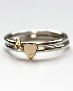 Stacked rings... with kids initails would be awesome! Great idea for a mother's ring