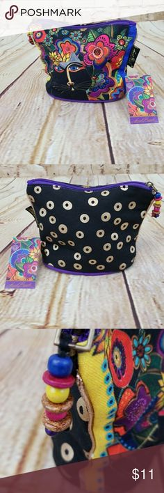 """LAUREL BURCH Kitty Pouch Adorbs! Small zippered bag 7""""x6""""x3"""" featuring the iconic LAUREL BURCH artfully portrayed cat in flowers on one side. Black with metallic gold circles on the other. Purple base and interior. NWT. Never used. Zip fob has decorative beads. Logo labels inside and out. Cutie pie. I ship fast. Laurel Burch Bags Mini Bags"""