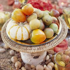 A pyramid of fall fruits and miniature squash plated on a birch-log pedestal is a simple but beautiful centerpiece.