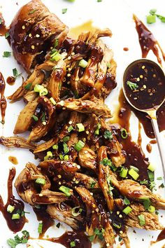NOM NOM!  Slow Cooker Honey Garlic Chicken - easy, slow cooked juicy chicken smothered in a sweet and spicy Asian garlic sauce that'll have you licking your fingers!