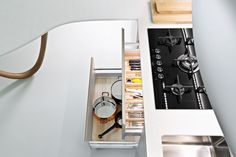 Snaidero #Cucine #Kitchen Top operational efficiency.  Opting for the Natural range, the interiors of drawers, #baskets and #columns were designed with bottoms in wood finish and equipped with solid ash fittings: a perfect interior organisation and an extraordinary sensorial quality.