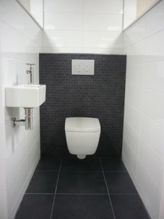 Beautiful black tiles behind the toilet. Fits the big black floor tiles - - Small Toilet Room, Guest Toilet, Downstairs Toilet, New Toilet, Bathroom Interior, Modern Bathroom, Small Bathroom, Small Sink, Bathroom Ideas