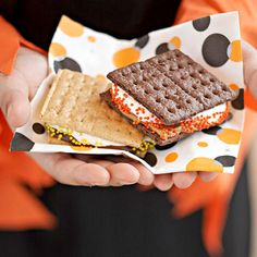 A Halloween-twist on s'mores. See the rest of this family-friendly Halloween party: www.bhg.com/halloween/parties/family-friendly-halloween-party/?socsrc=bhgpin100912halloweensmores#page=9