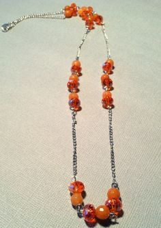 Orange beaded and silver chain necklace