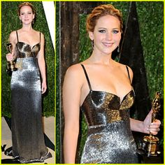 Jennifer Lawrence - Vanity Fair Oscars Party 2013. The 22-year-old actress looked absolutely beautiful in a Calvin Klein dress, Brian Atwood shoes, and Shay jewelry.