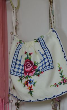 This listing is for a lovely handmade drawstring bag.    I made this bag from an old cross stitch doily. Size 27cm by 18cm