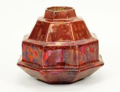 "A French Denbac Pottery Bowl. Octagonal ceramic vase is decorated in red and crystalline red glazes. Underside bears impressed ""Denbac"" marking. Denbac is the shortened form of ""Denert Et Balichon"" 7"" x 7.5"""