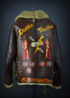 """carlosavo:  WWII bomber jacket from the crew of the """"Double Trouble"""". Part of the upcoming March 29th militaria auction at Savo Auctioneers LLC.Photoby Carlo Savo."""