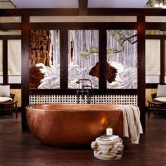 hand-hammered copper tub designed by artisan Robert Kuo, backed by a custom-designed glass-tile mural designed by tilemaker and artist Erin Adams.