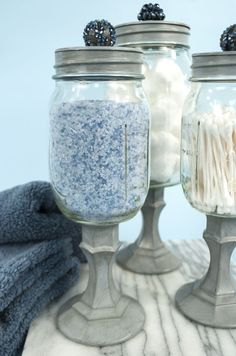 152770612333497363 Mason jars, candle stick holders, spray paint and cool little knobs. Oh the possibilities! Apothecary Jars