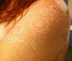 White ink tattoos. This looks sooo good on her skin color and hair!