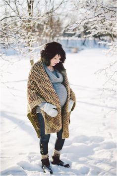 Winter maternity session in the snow.  Ariana Tennyson Photography