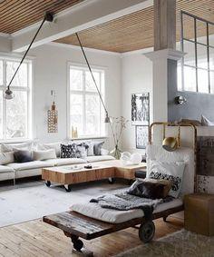 Exposed painted steel beams & timber ceiling