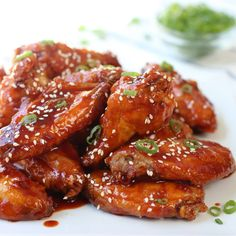 Spicy Baked Korean Chicken Wings - An Asian inspired baked wings recipe, perfect as appetizer and dinner! A fun party food for game day as well! Crispy chicken coated with spicy, flavorful gochujang based sauce. Spicy Korean Chicken, Korean Chicken Wings, Crispy Chicken Wings, Crispy Baked Chicken, Sesame Chicken, Korean Dishes, Korean Food, Chinese Food, Chicken Wing Recipes