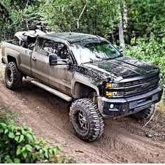 Brand new Chevy with a lift kit. Awesome blacked out Chevy Silverado. I'm a Chevy girl! Lifted Chevy Trucks, Gm Trucks, Diesel Trucks, Cool Trucks, Pickup Trucks, Mudding Trucks, Jeep 4x4, Jeep Truck, Chevrolet Silverado