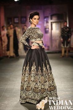 Kangana Ranaut walking the ramp in a black and white lengha for Anju Modi at India Couture Week 2014